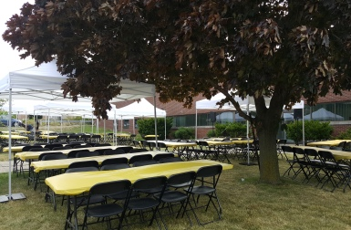 10 foot by 10 foot white pop up tents, tables and chair rentals delivered and set up for Corporate BBQ in Toronto
